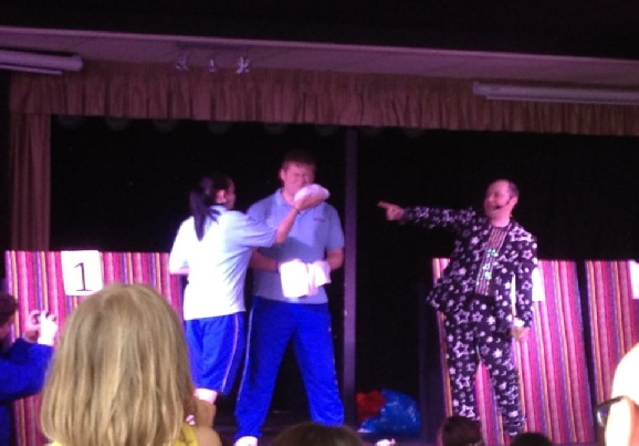 Damian Jay onstage with two contestants and The Dreaded Custard Pie - The Funky Funhouse Show
